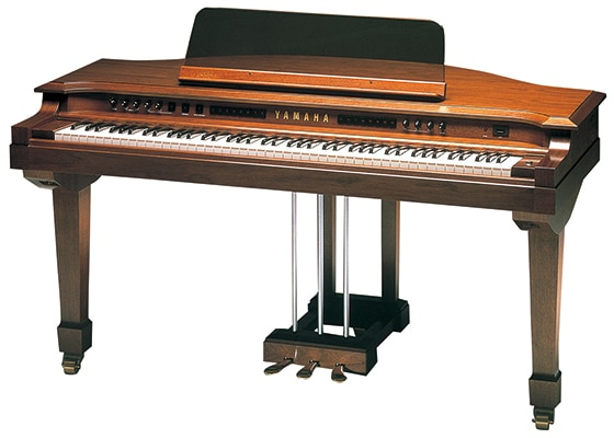 photo:Released in 1981, the GS1 digital keyboard featured FM tone generation and touch-sensitive control. Notable for its grand piano-like body, the GS1 was an expensive instrument that sold for 2.6 million yen.